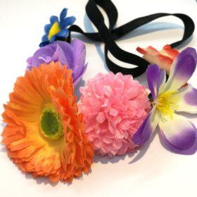 Blomster påsat elastisk hårbånd