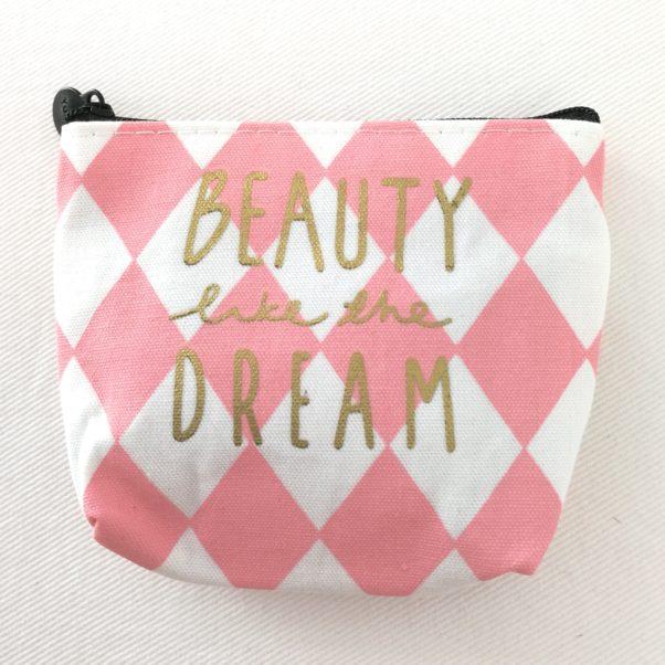 Fin lille pung i lyserød og hvid med teksten Beauty like the dream.