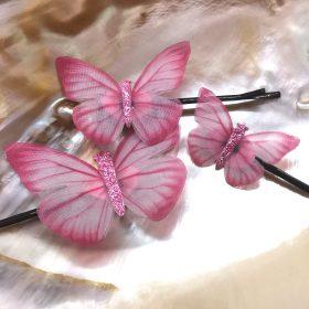 Yndige sommerfugle på hårnåle