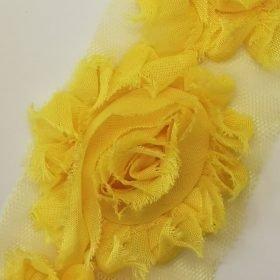 Stofblomster på tylnet – gul