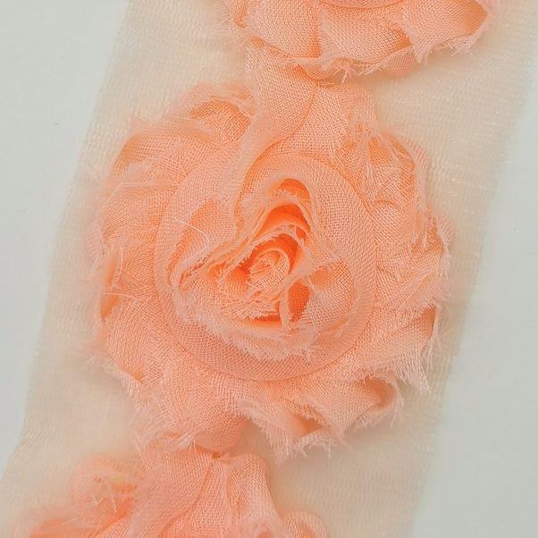 Stofblomster på tylnet - hot ferskenfarvet